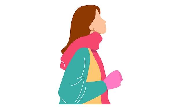 Senhora vestindo roupas de inverno ajeitando o lenço enrolado no pescoço
