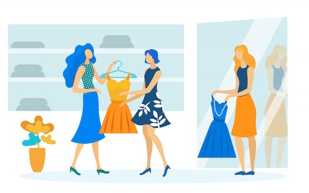 Senhoras experimentam vestidos liso