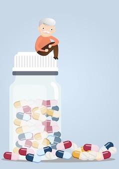 Senior com frascos de comprimidos.
