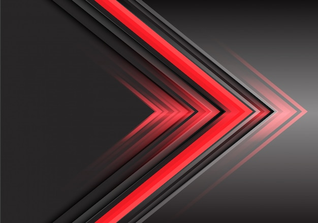 Sentido de poder vermelho da luz da seta no fundo cinzento.