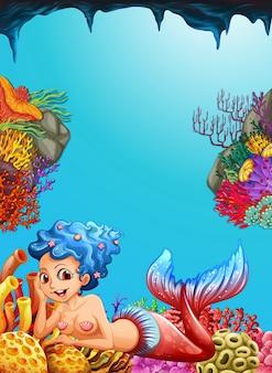 Sereia nadando sob o oceano