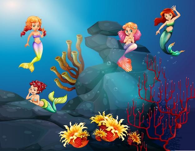 Sereias nadando sob o oceano