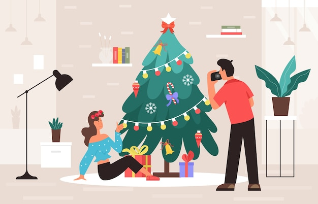Sessão de fotos de natal perto de um abeto na casa ou no interior do estúdio