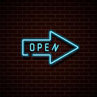 Seta azul de néon aberta em uma parede de tijolo