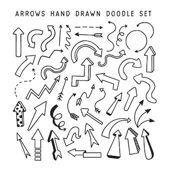 Setas de mão desenhada doodle conjunto