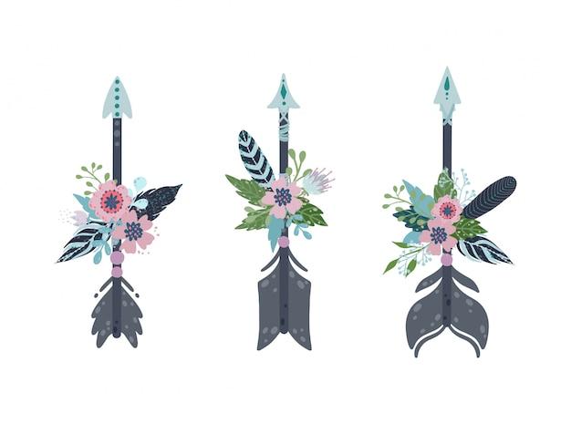 Setas étnicas boho definido. flechas, penas e decoração floral em estilo vintage boêmio.