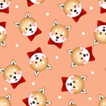 Shiba Inu cachorro com fita vermelha em fundo laranja