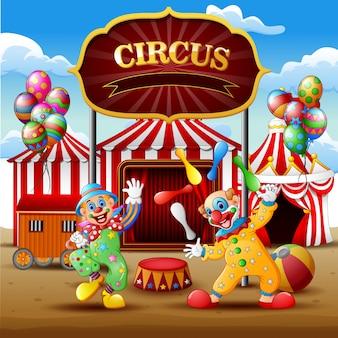 Show de palhaço dos desenhos animados e acrobata na arena