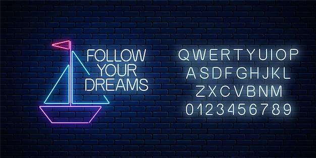 Siga seus sonhos - frase de inscrição de néon brilhante com placa de barco de papel com alfabeto na parede de tijolo escuro