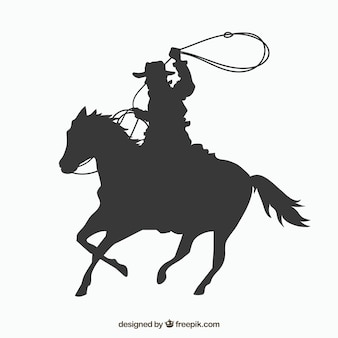 Silhouette cowboy riding horse