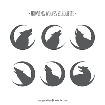 Silhouettes of wolves with moon collection