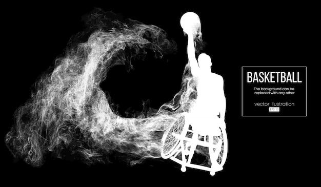 Silhueta abstrata de um jogador de basquete desativado em fundo preto escuro de partículas, poeira, fumaça, vapor. o jogador de basquete executa um lançamento de bola.
