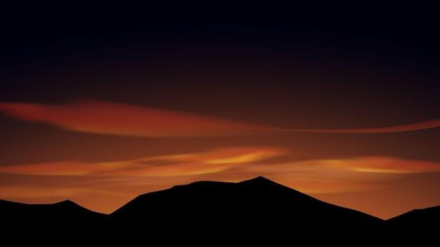 Silhueta da montanha com crepúsculo