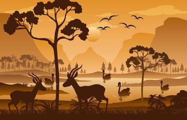 Silhueta da paisagem da floresta ao pôr do sol