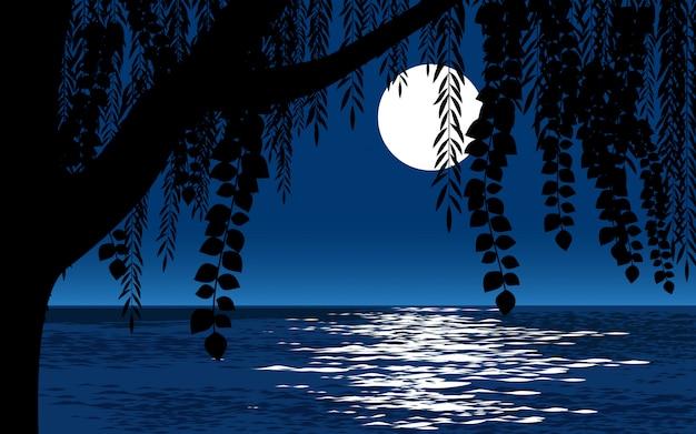 Silhueta de árvore grande e paisagem noturna de lua cheia