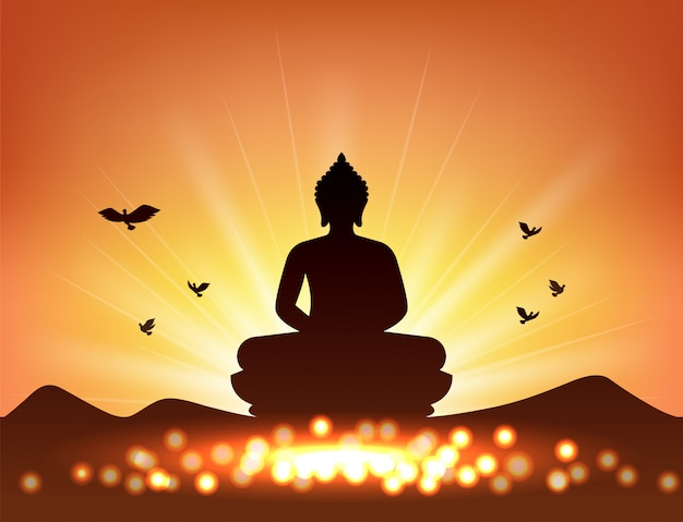 Silhueta de buda e luz de velas para o budismo