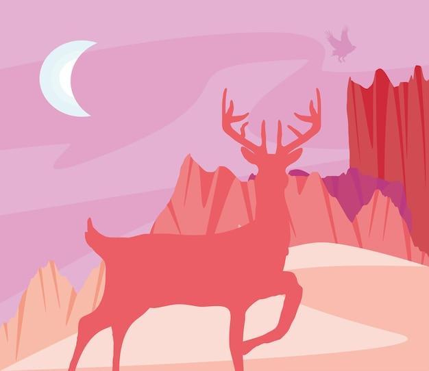 Silhueta de cervos à noite