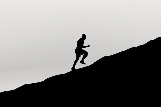 Silhueta de corredor na montanha