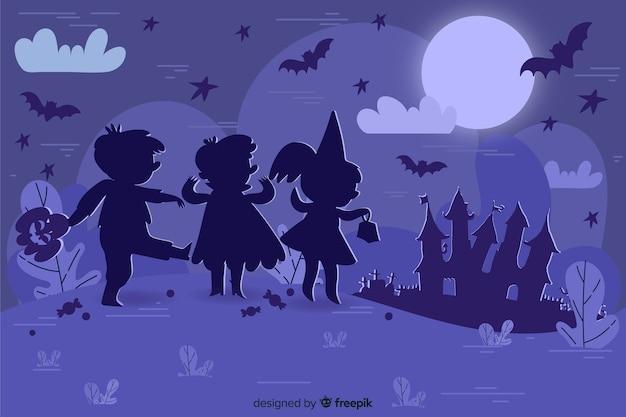 Silhueta de crianças desenhada à mão olhando para ilustração de halloween de uma casa mal-assombrada