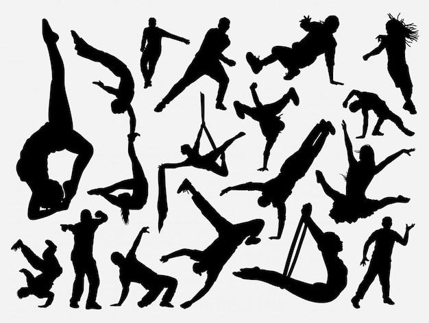 Silhueta de dança e acrobata