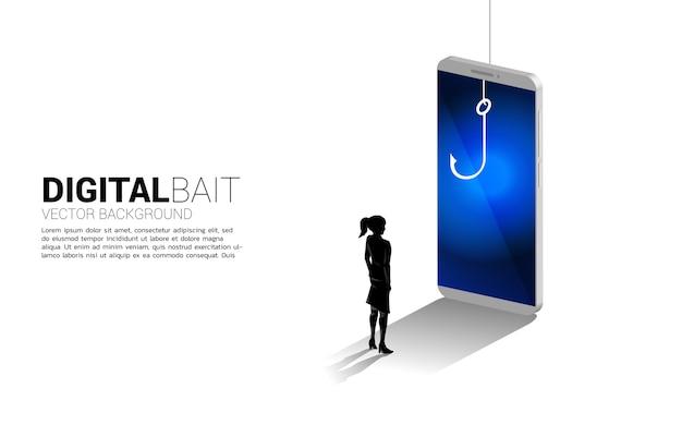 Silhueta de empresária em pé com anzol de pesca no celular. conceito de golpe digital e fraude nos negócios.