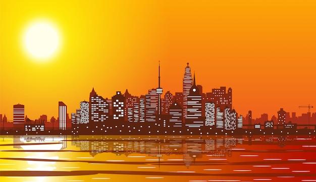 Silhueta de horizonte da cidade ao pôr do sol.