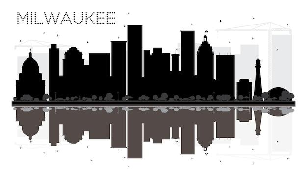 Silhueta de horizonte preto e branco de milwaukee city com reflexos. ilustração vetorial. conceito plano simples para apresentação de turismo, banner, cartaz ou site da web. paisagem urbana com monumentos.