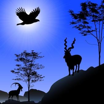 Silhueta de íbex e águia no fundo do sol