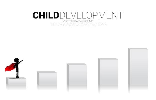 Silhueta de menino em super-herói no gráfico de barras. conceito de início da educação e futuro das crianças.