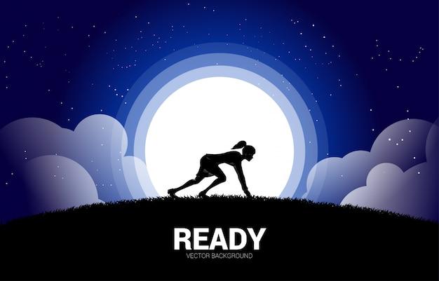 Silhueta de mulher de negócios pronta para correr na lua e na estrela. conceito de visão e objetivo da missão empresarial.