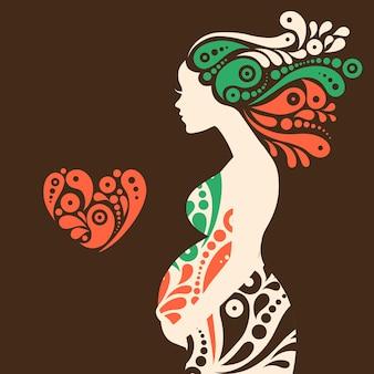 Silhueta de mulher grávida com flores decorativas abstratas e o símbolo do coração