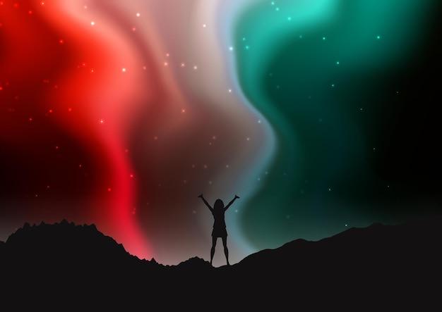 Silhueta de mulher na paisagem montanhosa à noite com o céu da aurora boreal
