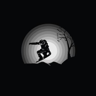 Silhueta de snowboarder pulando