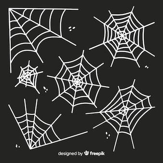 Silhueta de teia de aranha branca isolada em fundo escuro