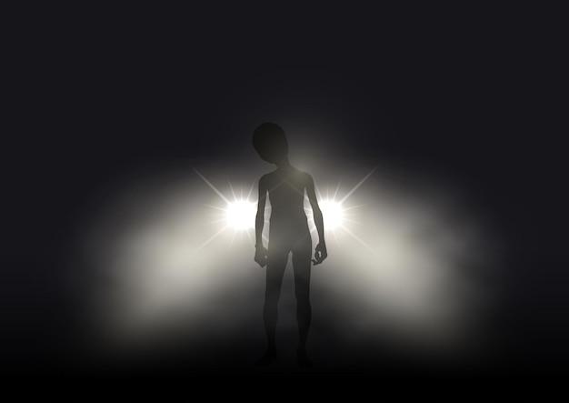 Silhueta de um alienígena iluminada pelos faróis de um carro em uma noite de nevoeiro