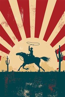 Silhueta de um cowboy cavalgando ao pôr do sol