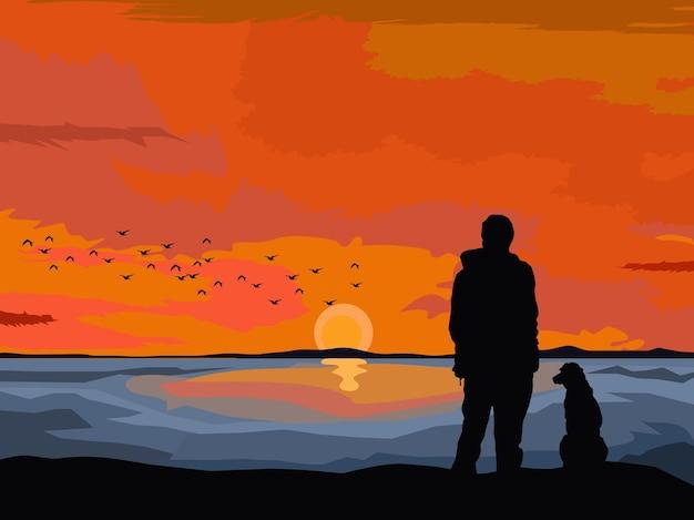 Silhueta de um homem e um cachorro de pé nas rochas à beira-mar com o pôr do sol ao fundo