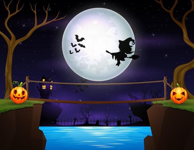 Silhueta de uma bruxa voando na noite de halloween