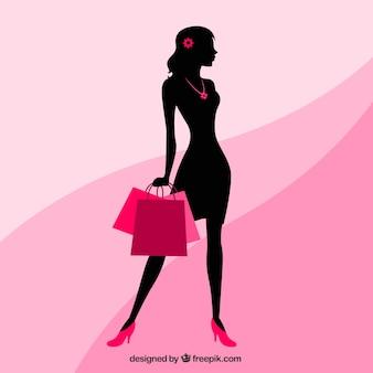 Silhueta de uma mulher com sacolas de compras