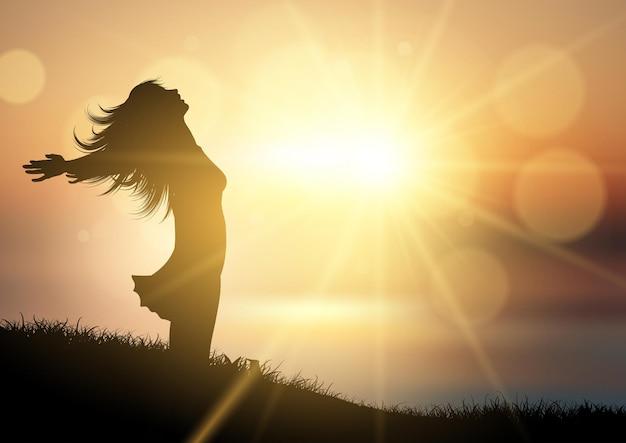 Silhueta de uma mulher feliz em uma paisagem de pôr do sol
