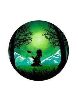 Silhueta de uma mulher grávida deixando um pássaro voar contra o pano de fundo de uma paisagem montanhosa verde