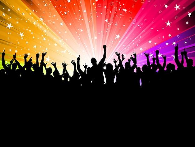 Silhueta de uma multidão de pessoas festeiras em um fundo starburst