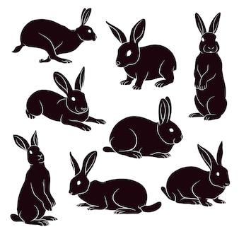 Silhueta desenhada de mão de coelhos