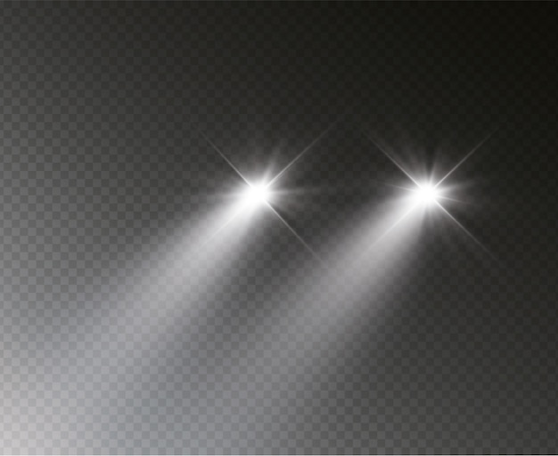 Silhueta do carro com faróis brilhando na escuridão.