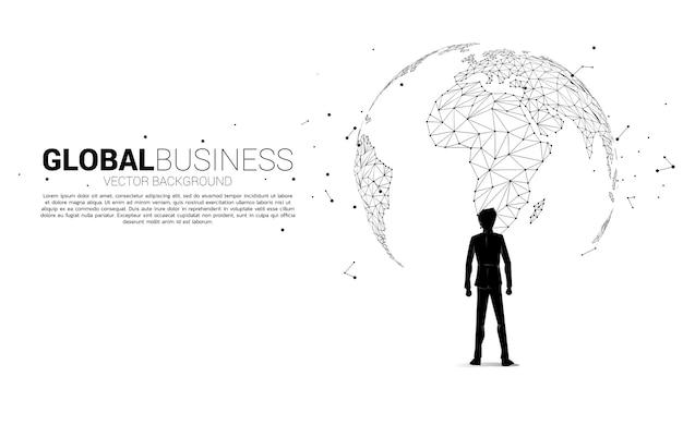 Silhueta do empresário de pé com o globo. conceito de negócio de missão de destino mundial.