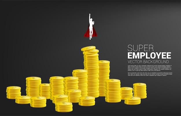 Silhueta do empresário voando da coluna mais alta da pilha de moedas. conceito de impulso e crescimento nos negócios.