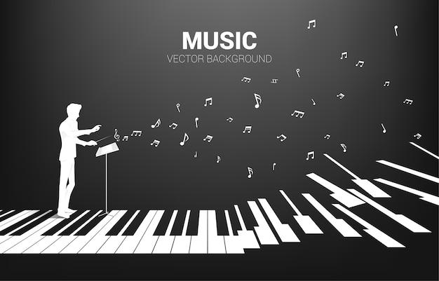 Silhueta do maestro em pé com tecla de piano com nota musical a voar. fundo de conceito para concerto de piano e recreação.