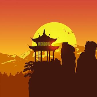 Silhueta do pavilhão chinês na montanha ao pôr do sol,