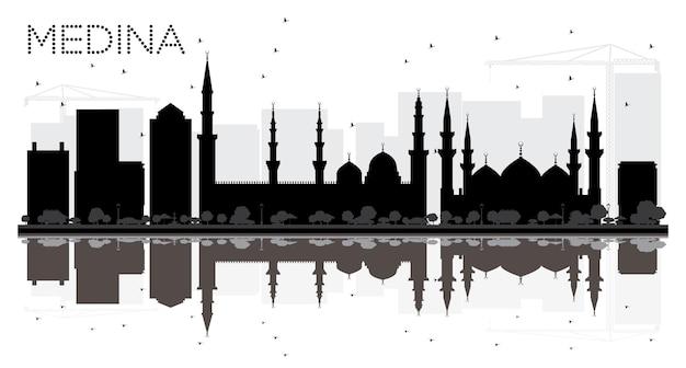 Silhueta preto e branco do horizonte da cidade da arábia saudita de medina com reflexões. ilustração vetorial. conceito de viagens de negócios. paisagem urbana com monumentos.
