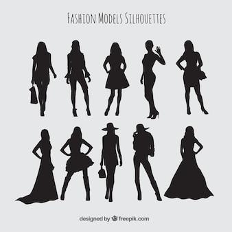 Silhuetas conjunto de modelos vestindo roupas elegantes